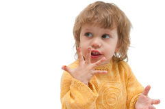 Girl licks fingers Royalty Free Stock Photos