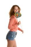 Girl licks giant lollipop Stock Images