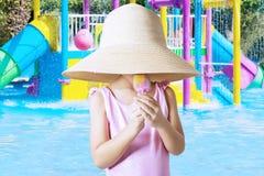 Girl licks ice cream at pool Royalty Free Stock Photography
