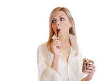 Girl licks a spoon with chocolate Stock Photo
