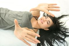 Girl lie down. Beautiful girl lie down on white background Royalty Free Stock Photos