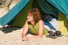 Girl lie near of tent. At sand beach Royalty Free Stock Images