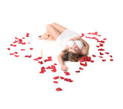 A girl lieing among rose petals Royalty Free Stock Image