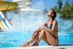 Girl lies on the backdrop of water slides. Royalty Free Stock Images