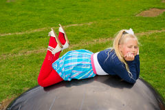 Girl lies ball Royalty Free Stock Images