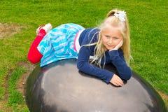 Girl lies ball Stock Image