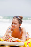 Girl lies on a beach plank bed Royalty Free Stock Photography