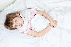 The girl lies in bed Royalty Free Stock Photography