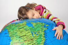 Girl lies on big inflatable globe and embracing it Stock Photo