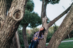 The girl lies and dreams on a tree. In the Park Royalty Free Stock Images