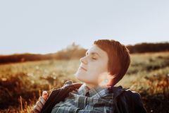 the girl lies in the field stock photography