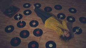 The girl listens to records.