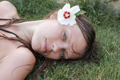 Girl lies on a grass Royalty Free Stock Photography