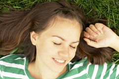 Girl lies on grass Royalty Free Stock Photo