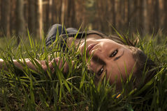 girl lies on a grass and dreams Royalty Free Stock Photos