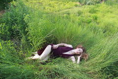 The girl lies in the grass royalty free stock images