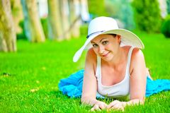 Girl lies on the grass Stock Photos