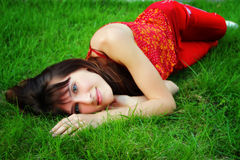 Girl lies on the grass Royalty Free Stock Photo