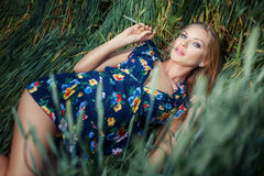 Girl lies in green grass. royalty free stock photography