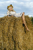 Girl lies on the haystack. Blond lies on the haystack Royalty Free Stock Photos