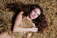 The girl lies in a haystack Royalty Free Stock Image