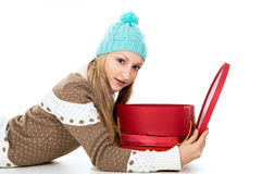 The girl lies and holds gifts Stock Image
