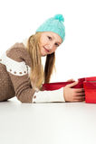 The girl lies and holds gifts isolated Royalty Free Stock Photos