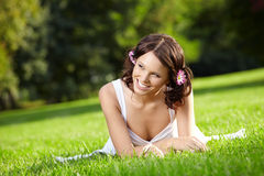 Girl lies on a lawn Royalty Free Stock Photo