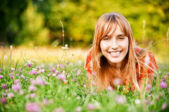 Girl lies on lawn Stock Photography