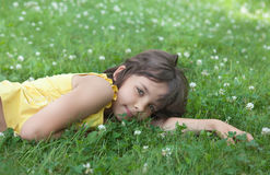 The girl lies on a  lawn. The girl lies on a green lawn Royalty Free Stock Photo