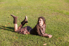 Girl lies on a lawn stock photography