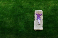 Girl  lies on mattress Royalty Free Stock Photo