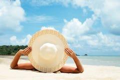 Free Girl Lies On The White Sand On The Beach Royalty Free Stock Photos - 197635018