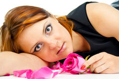 Girl lies in petals of a rose Royalty Free Stock Photos