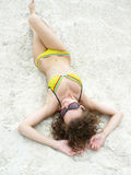 Girl lies on sand Royalty Free Stock Photography