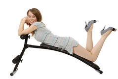 Girl lies on the  training apparatus Royalty Free Stock Image