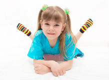 Girl lies on a white background royalty free stock image