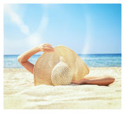 Girl lies on the white sand on the beach Stock Photography