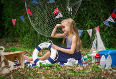 Girl with life-buoy looking afar Royalty Free Stock Images