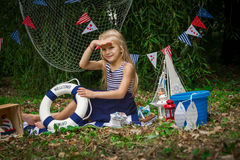 Girl with life-buoy ring looking afar Royalty Free Stock Photography