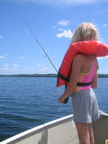 Girl with life jacket fishing. From a boat Royalty Free Stock Image