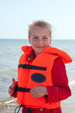 Girl with life jacket Royalty Free Stock Image