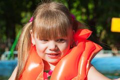 Girl in a life jacket smiling Royalty Free Stock Image