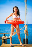 Girl with life saving buoy on pier Royalty Free Stock Images