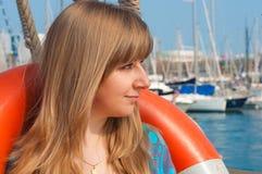 Girl with a lifebuoy Stock Photos