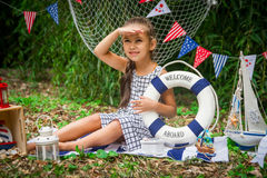 Girl with lifebuoy looking afar Stock Image