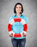 Girl with a lifebuoy Royalty Free Stock Photo