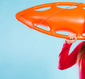 Girl lifeguard with equipment float Stock Photo
