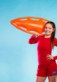 Girl lifeguard with equipment float Stock Photos
