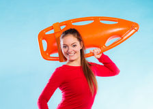 Girl lifeguard with equipment float Royalty Free Stock Images